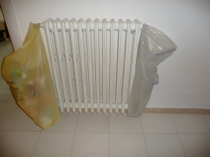 Who needs actual garbage totes when you can hang things on the radiator?  #Classy